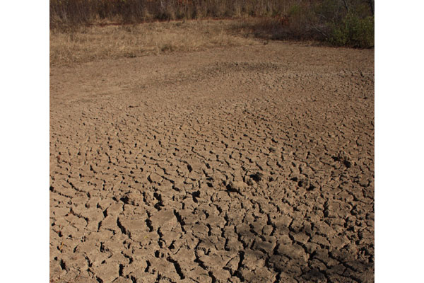 Dry ground is pictured amid a drought.