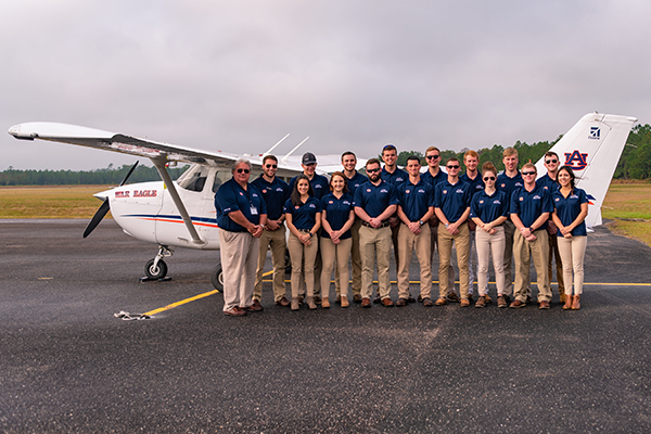 The War Eagle Flying Team in front of a plane
