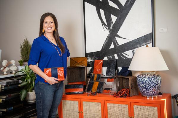 Elizabeth Purpich with handbags