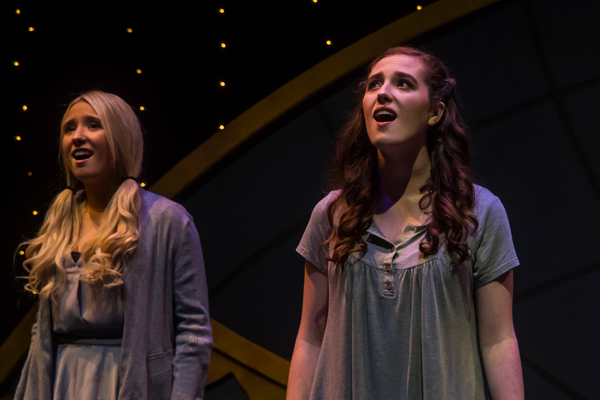 """Two actresses sing on stage during a production of """"The Theory of Relativity."""""""