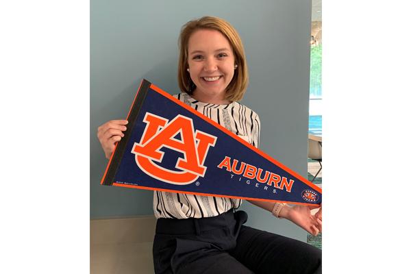 Megan Thompson holds an Auburn pennant.