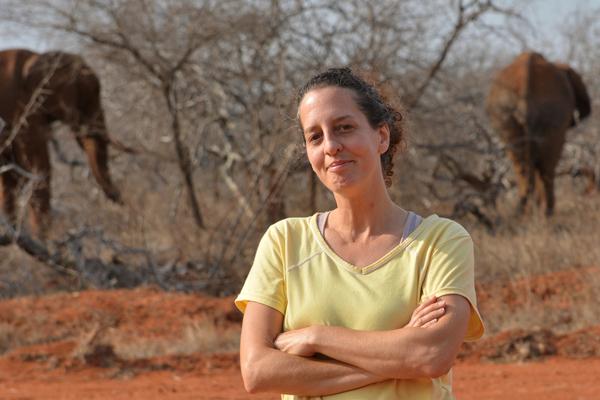 Lynn Von Hagen with elephants in the background.